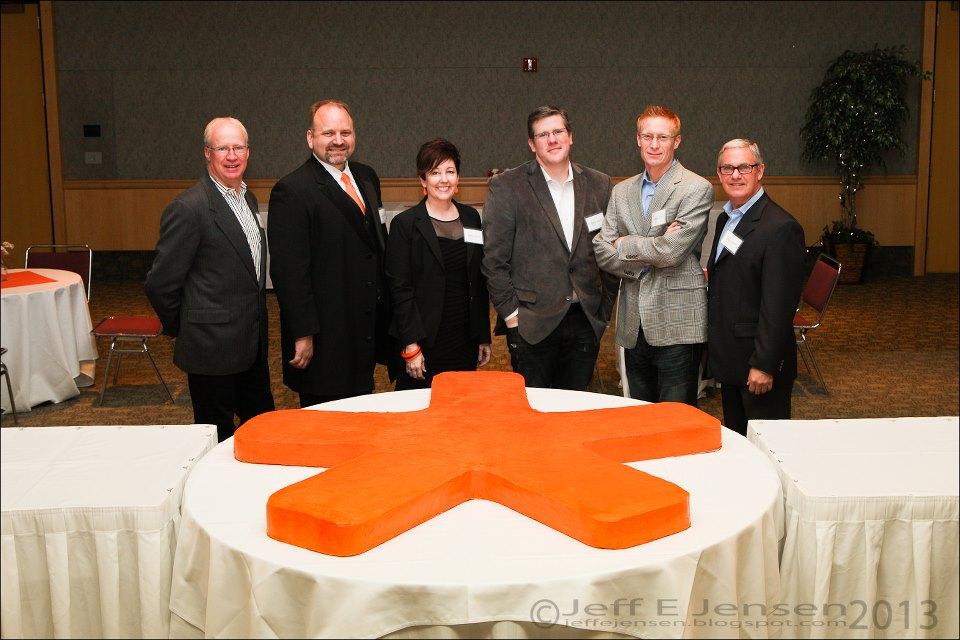MarketStar executives with asterisk cake